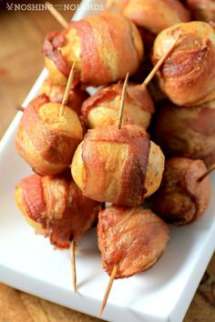 Little potatoes take a quick dunk in hot sauce and some spices and are then wrapped in bacon and baked to perfection!!
