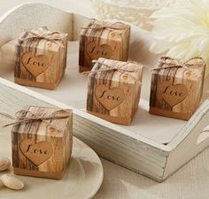 We've been on a tear for rustic or country wedding favors: Hearts in Love Rustic Favor Boxes (Set of 24)