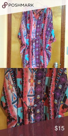 Size 16 Nicole Miller dress/tunic This size 16 Nicole Miller dress/tunic is new without tags. It is sheer with a pink slip lining underneath, which can be detached. This dress/tunic is brightly colored and flowy. Very cute! Nicole by Nicole Miller Dresses