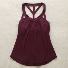 Victoria's Secret Halter Top Plum Sz XS This super sexy strappy halter top in plum is from Victoria's Secret and has a built-in bra that fits about a 32-34 A-B cup. Bra Tops Tops