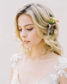 A touch of hellebore makes a pretty unique accent in this romantic, loose updo. @SarahJanks SarahJanks.com @JenHuangPhoto…
