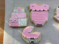 Sugar cookies onesi, baby carriage and shower presents by Baked Ambition.