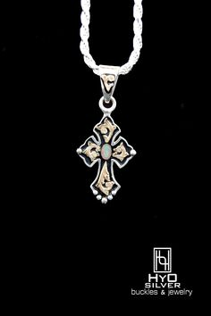 New item! Cross Pendant RRP002 ($170) w/Created Opal! A 4 mm x 6mm created opal captures vibrant greens, blues, and reds, that shimmer from all angles. Yellow gold scrolls fill the background of this classically designed small RimRock Cross Pendant. Silver beads accent the border while a black background antique adds contrast to the brilliant hues of the precious metals. Options of Blue Turquoise, Black Onyx, Purple Turquoise, or NEW Created Opal. www.hyosilver.com to order,
