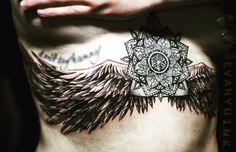 personal tattoo: mandala centre and torn wings over ribs