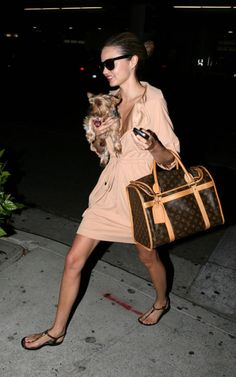 Louis Vuitton Dog Carrier.... Yet she's carrying the dog -___-