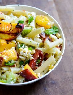 Heirloom tomato and grilled peach pasta salad with basil vinaigrette.