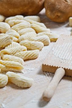 Gnocchi   1 pound russet potatoes, about 2 large ones  1 egg, lightly beaten  1/2 - 3/4 cups flour  1/2 teaspoon salt