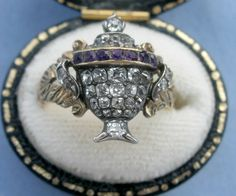Georgian diamond-amethyst mourning ring - The diamond and amethyst urn is a wide shape that follows the contour of the finger itself. circa 1800-1810