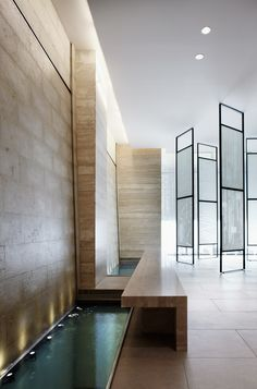 Travertine walls and long water basin, the Yonge & Eglinton condominium in Toronto by Munge Leung architects _ Nice glass screens Architecture Details, Interior Architecture, Modern Interior, Interior And Exterior, Hotel Lobby Design, Pool Water Features, Lobby Interior, Water Walls, Spa Design