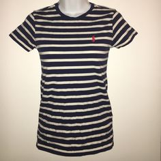 Striped Polo T-Shirt Adorable navy blue and white striped polo with red polo emblem. In great condition. Will fit an xsmall comfortable or a small more fitted. Ralph Lauren Tops Tees - Short Sleeve