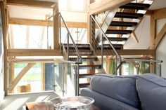 Roderick James Architects - stainless steel stair with wires and glass panels