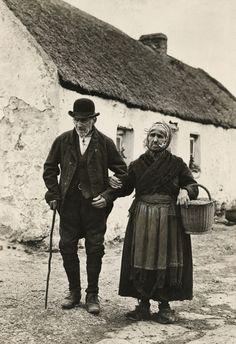 An elderly couple walk to the market in Galway, Ireland, circa Ireland Pictures, Images Of Ireland, Irish People, Erin Go Bragh, Irish Culture, Colette, Irish Cottage, Old Photography, Vintage Photographs