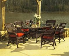 Princeton Outdoor Wicker Dining Set of 7 . $1895.00. Enjoy the company of friends and family around this vinyl wicker dining set crafted on an aluminum frame. The oval dining table (42w-72l-30h) features a hole for an umbrella (if you do not need the hole, we include a plug to cover the hole) with inset tempered glass top and 6 comfortable dining chairs (30w-22d-38h). Ships in 2-3 weeks.