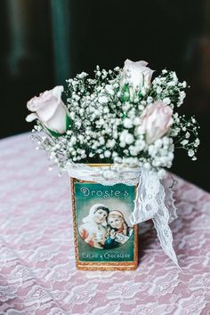 Simple vintage-inspired centerpieces - light pink roses + baby's breath in vintage tins {Krista Lajara Photography}