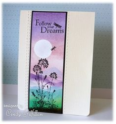 """By Cindy Gilfillan (frenziedstamper at Splitcoaststampers). Mask moon; sponge sky in spun sugar, then soft purples, intensifying colors at the top. Mask & sponge mountains in shades of purple, teal, & green. Stamp greeting, flowers (from Stampin' Up's """"Serene Silhouettes""""), & dragonflies. Sponge dark brown on bottom edge. Mat, attach to base, score."""