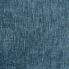 An abstract velvet fabric with slight texture in a dark denim blue. This high-performance velvet is suitable for heavy-use furniture such as