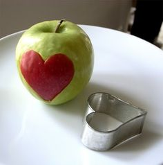used cookie cutter to cut shape out of one red and one green apple, then traded pieces. cute-food