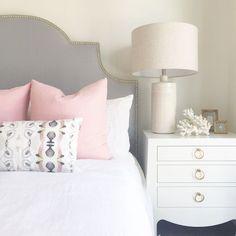 BECKI OWENS--bedroom with gray linen upholstered headboard, pink pillows, white nightstand, coastal styling. Home Bedroom, Master Bedroom, Bedroom Decor, Bedroom Ideas, Bedroom Interiors, Design Bedroom, Bed Ideas, Bedroom Inspo, Bedroom Inspiration