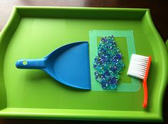 """Learning how to clean up.  Sweep the beads inside the rectangle, to """"pile them"""".  Also teaches inside and outside of a line, shape, or area."""
