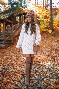 Easy Thanksgiving Outfit Ideas – Cream sweater dress with camel over the knee boots (Southern Curls