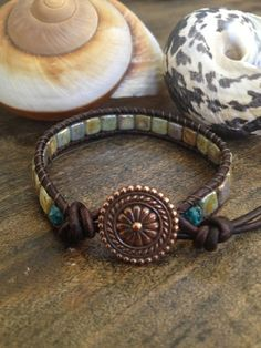 Gorgeous Picasso Tila beads are handwoven onto antiqued distressed brown leather cord accented with a stunning copper Bali button clasp.