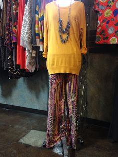 We love this outfit with a yellow light weight knit top and palazzo pants!