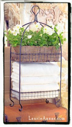 "2 tier black metal rack w/baskets $59.95 free ship limited quantities.  33"" tall x 14.5"" wide x 8.5"" deep; use for towels or plants or office supplies!"