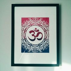 "Three coloured ""Om"" print matted and framed looks beautiful when hung on the wall.  #om #aum #amen #shanti #screen #screenprint #silkscreen #print #printmaking #illustration #canadianMade #handmade #madebyhand #limited #limitedEdition #art #artist #artoftheday #instaartist #instagood #instaart #artsy #design #bestoftheday #ig #igers #igaddict #madeInToronto #madeInCanada #localTO"