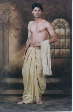 Dhoti-- a long, rectangular piece of unstitched cloth wrapped around the waist and the legs and knotted at the waist; the methods of wrapping and knotting vary in style; worn by men only; can be long or short. Indian Man, Indian Groom, Mode Masculine, 3d Foto, Indian Fashion, Mens Fashion, Pose Reference Photo, Straight Jacket, Groom Wear