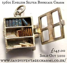 1960s English silver opening bookcase charm with enamel-painted books inside.  Marked 'SILVER Nuvo Regd.' 145.00 UK£. Sold Oct 2010. Photo © Sandy Turton,  North Lincolnshire, England via SandysVintageCharms online.