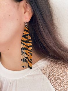 These exclusive tiger print ornament fringe earrings were designed and beaded by me from scratch. You can be sure that your earrings have exclusive original design 💫 Long dangle and drop golden brown, iris yellow and black earrings. Bright, eye-catching, perfect for boho style. Unique beaded Prom Earrings, Black Earrings, Seed Bead Earrings, Fringe Earrings, Beaded Earrings, Statement Earrings, Earrings Handmade, Beaded Jewelry, Jewellery