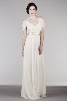 """This romantic, sheer V-neck dress is a reinvention of one of our classic favorite styles. The added drama, with ever so softly dropped shoulders, is in perfect harmony with the flowiness of the dress for truly effortless elegance. Made of 100% silk: • Top layer: Off white silk chiffon. • Lining: Cream silk charmeuse. • The dress comes with 2"""" eggshell satin sash. • Should be worn with a regular strapless bra. ***Size 12 & 14 is currently sold out. We are taking pre-orders for start shi..."""