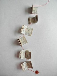 Decorating the library: tiny books garland, paper garland, One Bunting Away Upcycled Crafts, Book Page Garland, Paper Art, Paper Crafts, Paper Book, Book Page Crafts, Recycled Books, Recycled Art, Thrift Store Crafts