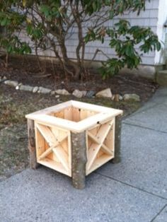 Planter box with legs made from downed tree limbs. Approximately 15 high and 15 wide. Stain can be added for an extra cost. Can be picked up or delivered for a fee in the Rhode Island or Connecticut area. Contact me for details.