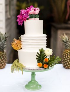 tropical wedding cake topped with flamingo
