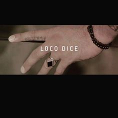 Loco Dice is wearing his own Logo Ring in Sterling Silver and Black Enamel by @manuelbozzi @locodice