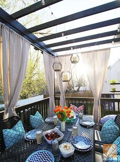 DIY Outdoor Decor Ideas: A Pergola, a Cluster of Hanging Lanterns, Outdoor Curtains and Colorful Outdoor Decor. Fantastic Patio Makeover!  by Jen Stagg of withHeart  #BringInSpring