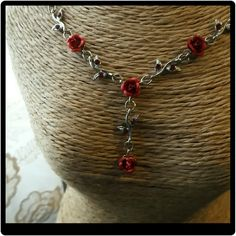 NEW Gorgeous Silver Red Rose Necklace This necklace is just breathe taking. Has 6 red roses and leaves with red stones. Measures about 9 inches and can be hooked shorter. Jewelry Necklaces