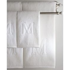 The Matouk Auberge Bath Collection features a decorative capital letter in relief on white Egyptian cotton terry.