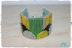 Bracciale con perline argentate gialle e nere con soutache giallo e verde lungo 18 cm by Paola Longo creazioni https://www.facebook.com/pages/Paola-Longo-creazioni/615398268566782?fref=photo
