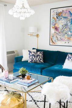 blue velvet sofa || statement light fixture