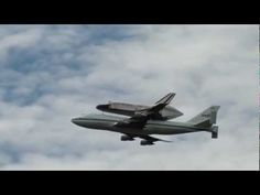 Space Shuttle Discovery Flies Over the National Mall