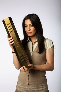 Laila Rouass played Sarah Page, shown here holding the artifact on Primeval, BBC TV series.