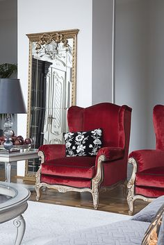 Red and gold touches in a classic interior on #lakecomo
