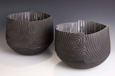 'Vortex I, Vortex II' Coil-built, altered raku fired ceramic 30 x 32 cm. & 28 x 31 cm.