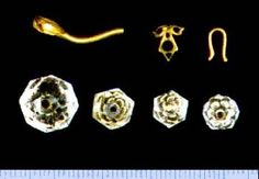 Pieces from a necklace/ on the top left is a blouse pin.that belonged to a Grand Duchess. Found at the Romanov burial site in 1998. Cr. ghost of the ipatiev house/tumblr