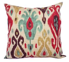 This listing is for two ikat throw pillow covers in a red and brown ikat print with spa blue accents. These modern pillow covers would be a