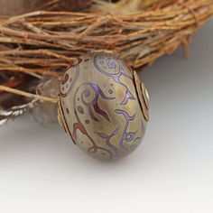 Metallic Scrolls Hollow Glass Focal Bead  Also the single most beautiful bead in the world, and MINE