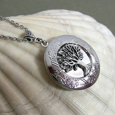 Hey, I found this really awesome Etsy listing at https://www.etsy.com/listing/193774658/tree-of-life-locket-silver-locket-celtic