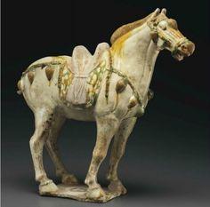 A sancai-glazed pottery figure of a horse, Tang dynasty (AD 618-907)